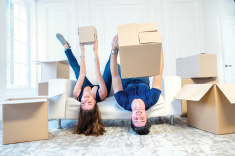 stock-photo-70521171-moving-new-apartment-couple-girl-and-the-guy-hold-boxes