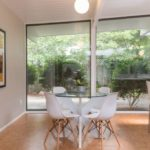 mid century rummer with lots of natural light throughout