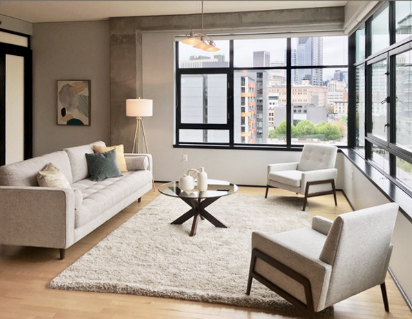 Defining the space in the Elizabeth Loft in the living room through staging clean modern lines