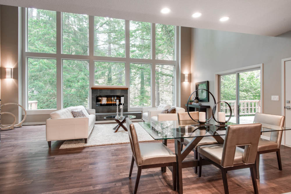 Look at this large great room for entertaining and relaxing while looking out from those breathtaking windows