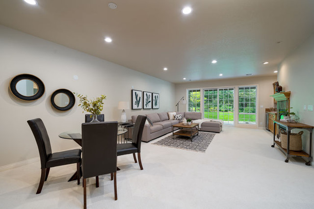 we staged the family room with a large sectional for relaxing while watching tv and bistro table for card games or drinks